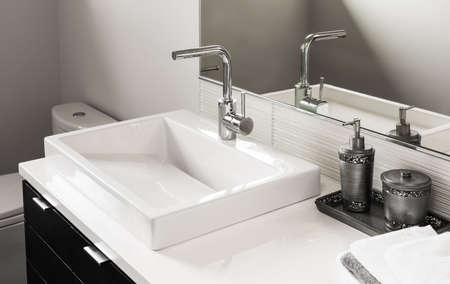 sink and vanity in new luxury home Stok Fotoğraf