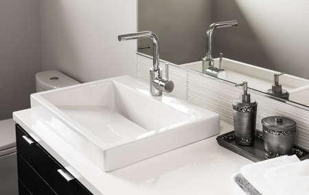 sink and vanity in new luxury home Standard-Bild