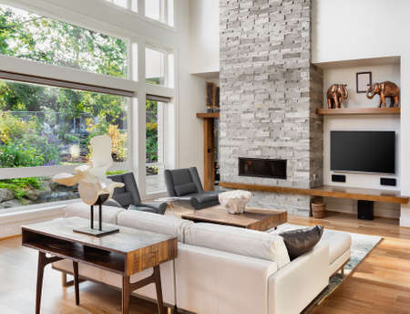 living room interior with hardwood floors and fireplace in new luxury home Stock Photo