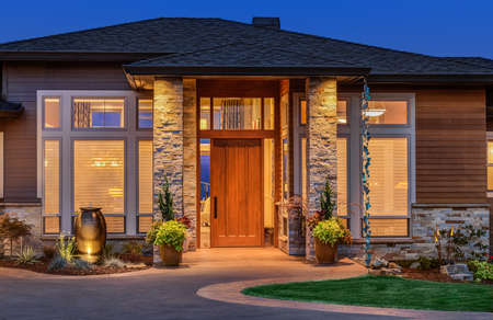 front door: Front elevation of luxury home in evening