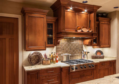 cabinets: Home Stove Top Range and Cabinets in New Luxury Home