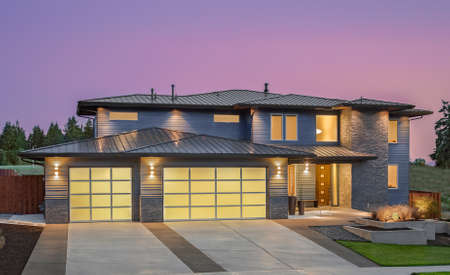 suburbs: Beautiful Exterior of New Luxury Home at Sunset