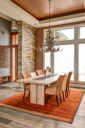 home furnishing: Dining Room with Entryway, Table, Elegant Light Fixture