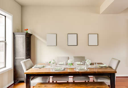 dining table and chairs: Furnished Dining Room with Place Settings