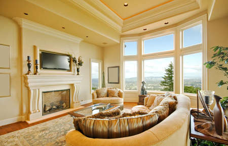 fireplace living room: Beautiful Living Room Interior in Luxury Home with Fireplace, TV, and Expansive View with Blue Sky