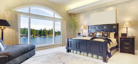 hotel bedroom: Beautiful Bedroom in Luxury Home with Gorgeous Lakeside View