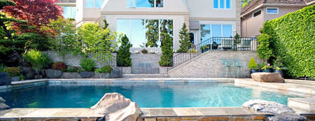 contemporary: Home Exterior: Backyard Exterior Panorama with Pool