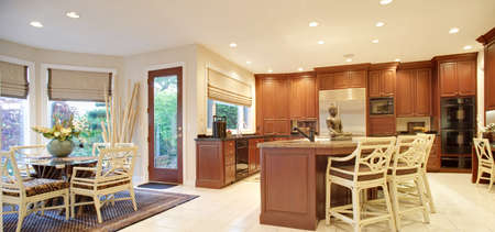 kitchen tile: Newly constructed home with beautiful furnished kitchen and dining room Stock Photo