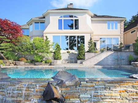 exterior wall: New Home with Backyard Infinity Pool Stock Photo