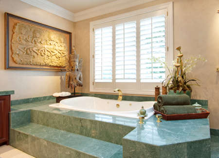 bathroom interior: beautiful master bathroom interior with large bathtub