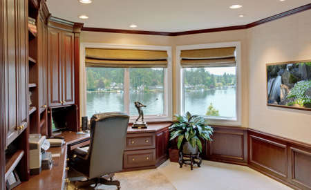 lake dwelling: Den and office in Luxurious New Home with View of Lake