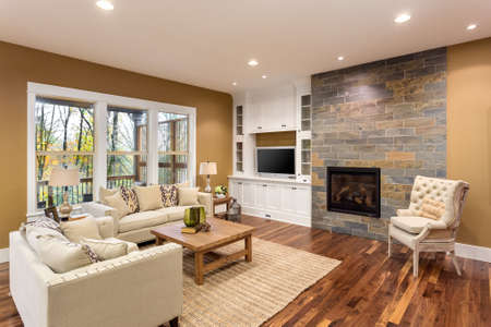 hardwood: Beautiful living room interior with hardwood floors and fireplace in new luxury home