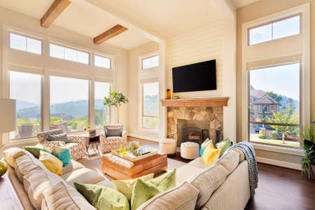 Beautiful living room in luxury home with hardwood floors and amazing view