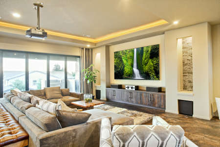 living room sofa: Entertainment Room and Living Room in Luxury Home Stock Photo