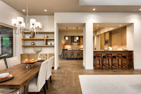 Living room, dining room, and kitchen in new luxury home