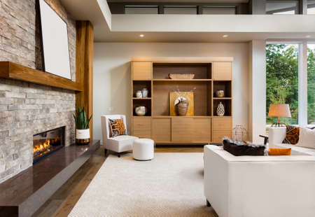 fireplace home: Beautiful living room interior with hardwood floors and fireplace in new luxury home