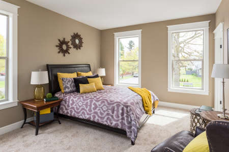 Furnished master bedroom interior in new home