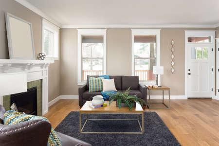 Beautiful living room interior with hardwood floors and fireplace in new home Banco de Imagens