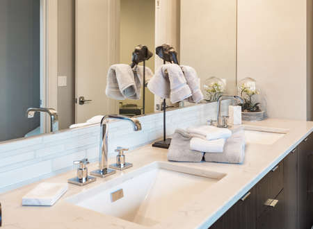 bathroom detail: double vanity sinks in new luxury home