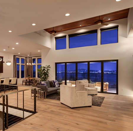 Beautiful living room with hardwood floors and amazing view at night