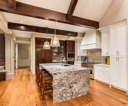kitchen cabinets: Kitchen with Island, Sink, Cabinets, and Hardwood Floors