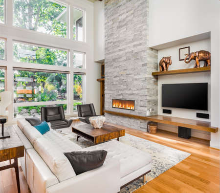 Beautiful living room interior with hardwood floors and fireplace in new luxury home