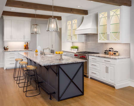 Amazing Kitchen in New Luxury Home with Glass Fronted Cabinets, Island, and Hardwood Floors