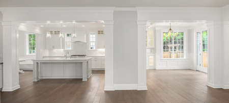 Panorama of beautiful kitchen and dining room in new luxury home