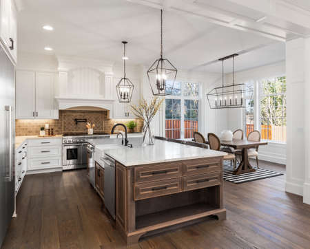 Beautiful kitchen in new traditional style luxury home, with quartz counters, hardwood floors, and stainless steel appliances Archivio Fotografico