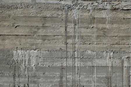 impress: Concrete wall with wooden pattern impress from wooden form board shuttering and with sags of cement