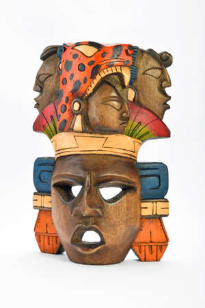 mayan culture: Indian Mayan Aztec wooden painted mask with roaring jaguar and human profiles isolated on white background