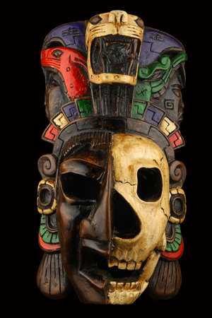 Mexican Mayan Aztec ceramic painted mask with skull isolated on black Stok Fotoğraf