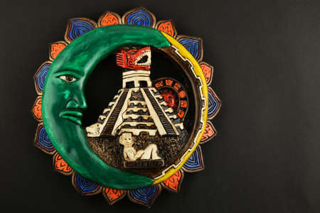 mayan culture: Mexican Mayan Chichen Itza souvenir ceramic painted plate with Moon, pyramid and girl isolated on black paper