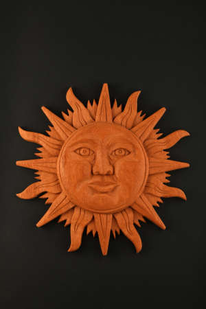 mayan culture: Mexican traditional Mayan culture wooden carved sun symbol plate isolated on black