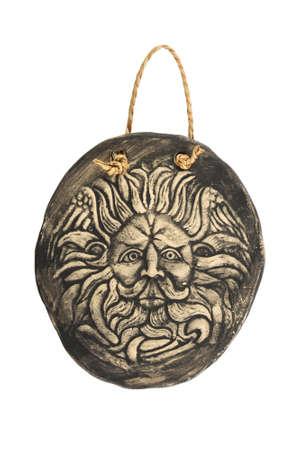 minerva: Tourist ceramic souvenir replica of male Gorgon Medusa head in Minerva temple in Roman Bath in England isolated on white