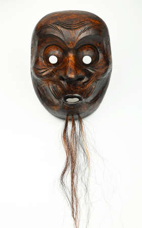 noh: Japanese wooden carved theater mask of human face with beard and moustache isolated on white background
