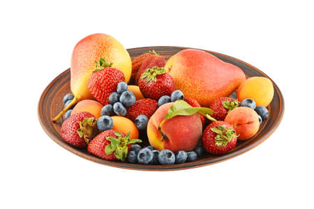 mellow: Mellow fresh summer fruits and berries mix in ceramic plate isolated on white, strawberries, blueberries, apricots, peach and pear