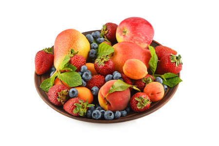 mellow: Mellow fresh summer fruits and berries mix with mint leaves in ceramic plate isolated on white, strawberries, blueberries, apricots, peach and pear
