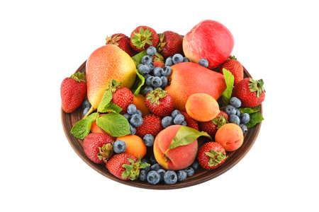 mellow: Mellow fresh summer fruits and berries mix with mint leaves in ceramic plate isolated on white, strawberries, blueberries, apricots, peach, apple and pear