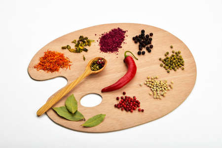 pepper flakes: Palette of spices, collection of various spices on wooden palette isolated on white Stock Photo