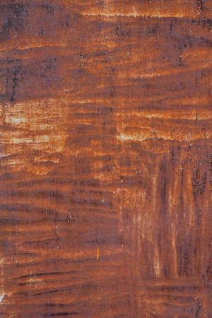 pitting: Bright rust stained corroded metal surface with uneven paint