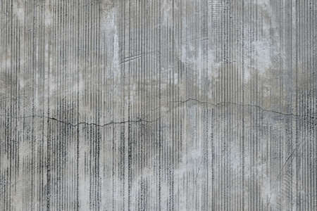split level: Grey concrete wall with parallel traces from rubbed finish processing abrasive machining and crack check