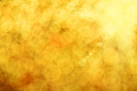 sunshine abstract: Golden glitter bright magic light circles summer sunshine abstract blur effect background