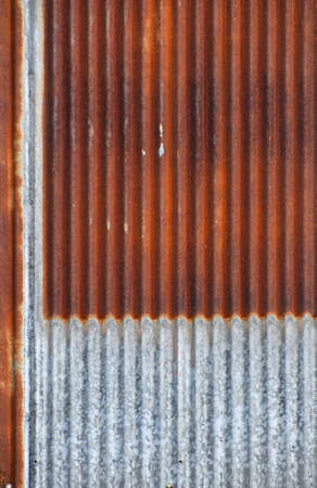 corrosion: Old vintage bright rusty stained corroded metal goffered surface