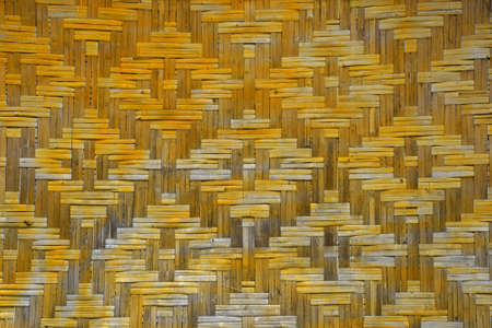 webbed: Wicker braided bamboo yellow and brown painted wall texture pattern
