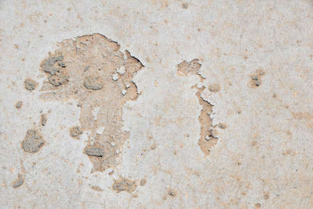 fault: Africa shaped damage fault defects in grunge concrete wall or floor with stains background