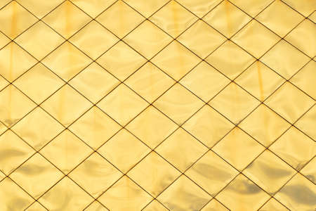 highlights: Golden metal shiny vivid rooftop tile panels texture background with highlights and reflections