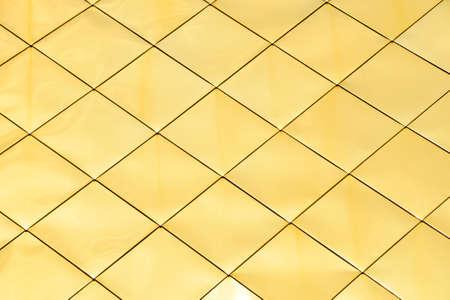 shiny metal background: Golden metal shiny vivid rooftop tile panels texture background Stock Photo