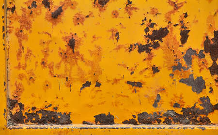 defects: Grunge old yellow painted damaged rusty corroded yellow texture background with stains, defects, flakes and scales