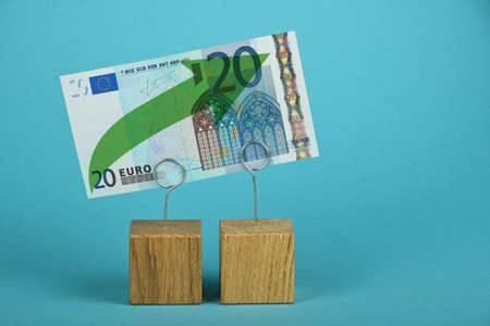 twenty euro banknote: Growth and support of European economy and Euro, twenty Euro banknote with green arrow up on two holders over blue background Stock Photo